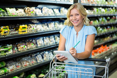 Smiling woman ticking off list Royalty Free Stock Photo