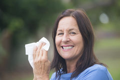 Smiling Woman with tissue outdoor Stock Images