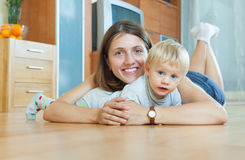 Smiling woman with toddler on  floor Stock Photography