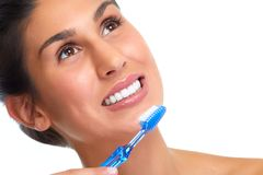 Smiling woman with toothbrush. Royalty Free Stock Photo