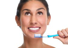 Smiling woman with toothbrush. stock photo