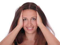 Smiling woman touching head Stock Photography