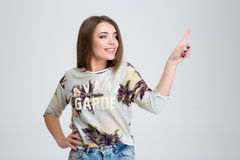 Smiling woman touching invisible screen Stock Photos
