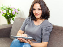Smiling woman and touchpad Stock Image