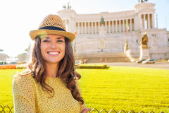 Smiling woman tourist in front of the Venice Square in Rome Stock Photos