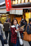 Smiling woman tourist hold map Royalty Free Stock Photos