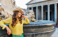 Smiling woman tourist leaning on the Pantheon fountain in Rome Royalty Free Stock Image