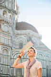 Smiling woman tourist with map sightseeing in Florence, Italy Royalty Free Stock Images