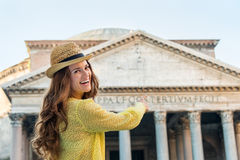 Smiling woman tourist pointing at Pantheon in Rome in summer Stock Image