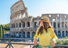 Smiling woman tourist relaxing near Colosseum in Rome in summer Stock Photo