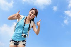 Smiling woman tourist showing thumbs up Royalty Free Stock Images