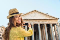 Smiling woman tourist taking photo of Pantheon in Rome Stock Photo