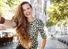 Smiling woman tourist taking selfie near Sagrada Familia Royalty Free Stock Images