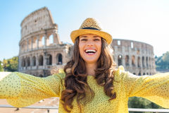 Smiling woman tourist taking selfie at Rome Colosseum Royalty Free Stock Photo