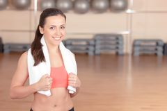 Smiling woman with towel in gym Royalty Free Stock Photography