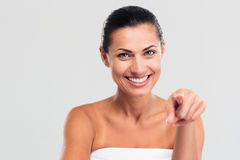 Smiling woman in towel pointing finger at camera Royalty Free Stock Image