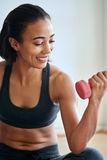 Smiling woman training with dumbbells Stock Photos
