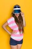 Smiling Woman In Transparent Plastic Blue Sun Visor Royalty Free Stock Photo