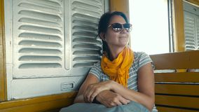 Smiling woman traveling by train. Video of a smiling woman traveling by train in thailand stock video footage