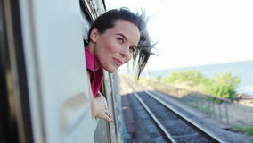 Smiling woman traveling by train stock footage