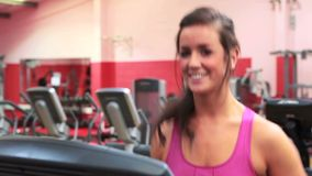 Smiling woman on treadmill stock footage
