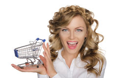 Smiling woman with trolley for shopping Stock Image