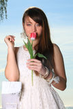 Smiling woman with tulip flowers Stock Photography