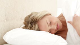 Smiling woman turning off her alarm stock video