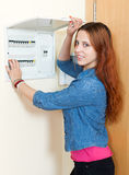 Smiling woman turning off the light-switch. At home stock photos
