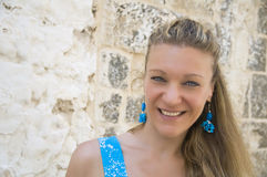 Smiling woman with turquoise earrings. Royalty Free Stock Photo