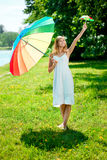 Smiling woman with two rainbow umbrellas, outdoors Stock Images