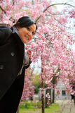 Smiling woman under cherry tree Stock Image