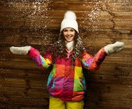 Smiling woman under snow Stock Photo