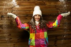 Smiling woman under snow Stock Images