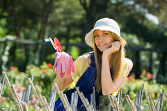 Smiling woman  in uniform at yard gardening Royalty Free Stock Images