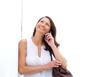Smiling woman using cell phone and looking up Royalty Free Stock Photos