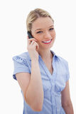 Smiling woman using cellphone Stock Images