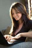 Smiling woman using computer Royalty Free Stock Photos