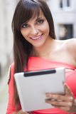Smiling Woman Using Digital Tablet Royalty Free Stock Photo