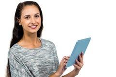 Smiling woman using digital tablet Stock Image