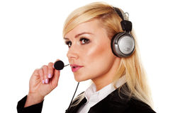 Smiling woman using headphones and mike Royalty Free Stock Photography