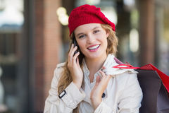 A smiling woman using her phone Stock Photos