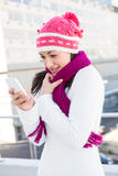 Smiling woman using her smartphone. Outside Stock Photography