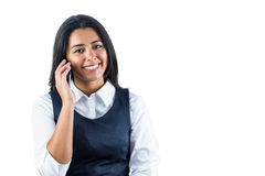 Smiling woman using her smartphone to make a call Royalty Free Stock Images