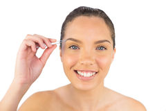 Smiling woman using her tweezers Stock Photos