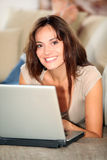 Smiling woman using internet Royalty Free Stock Images