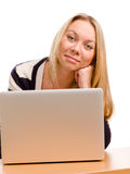 Smiling woman using a laptop Stock Photos