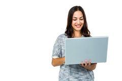 Smiling woman using laptop Royalty Free Stock Photos