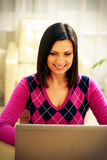 Smiling woman using laptop Royalty Free Stock Images