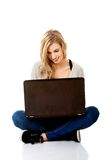 Smiling woman using a laptop Royalty Free Stock Photo